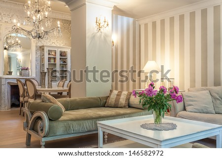 Vintage mansion - a beige lounge in a retro apartment - stock photo