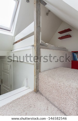 Vintage mansion - a bright garret with a bed - stock photo