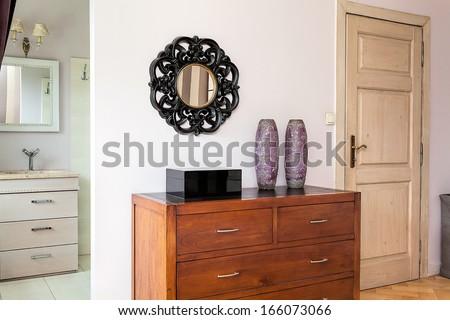Vintage mansion - dark brown wooden chest of drawers - stock photo