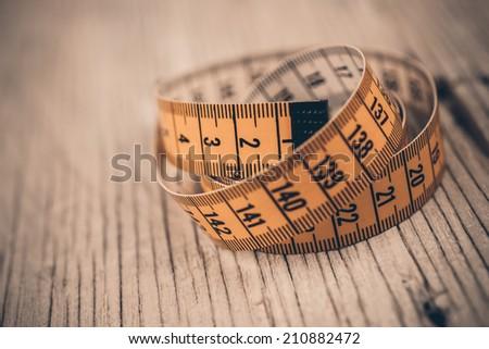 vintage measuring tape - stock photo