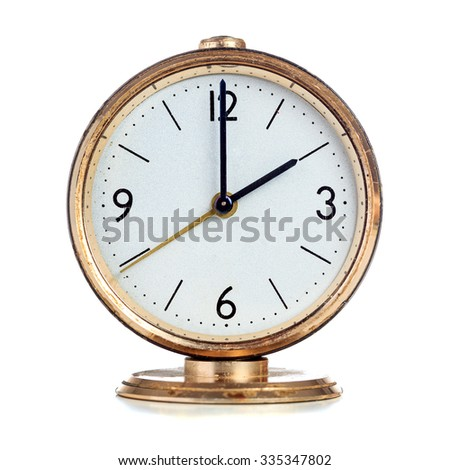 Vintage mechanical alarm clock showing two o'clock isolated over white - stock photo