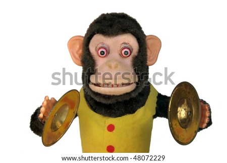 Vintage mechanical monkey with toy cymbals - stock photo