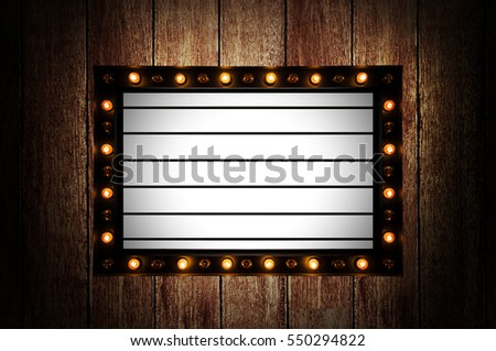 Vintage message board with light box and light bulb on wooden wall