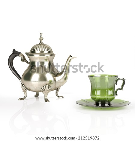 Vintage Metal Coffee Pot With Cute Green Cup On White Background - stock photo