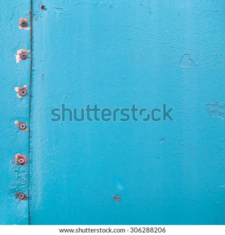 Vintage metal covering. emerald color paint skin with rivet. copy space. Soft focus. - stock photo