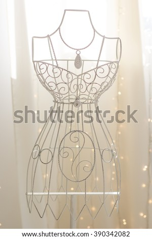 Vintage metal hanger in dress shape - stock photo