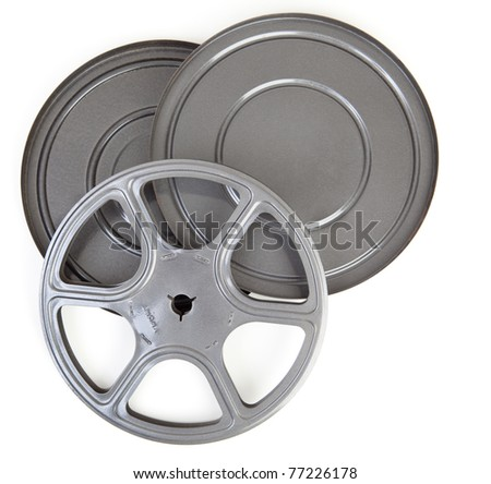 Vintage metal 8MM movie reel and case tin. - stock photo