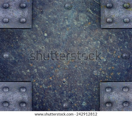 Vintage metal plate with rivets - stock photo