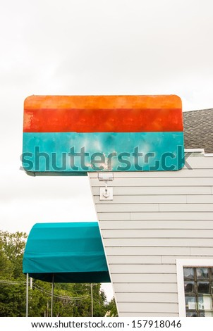 Vintage metal sign outside a retro styled roadside  restaurant and bar - stock photo