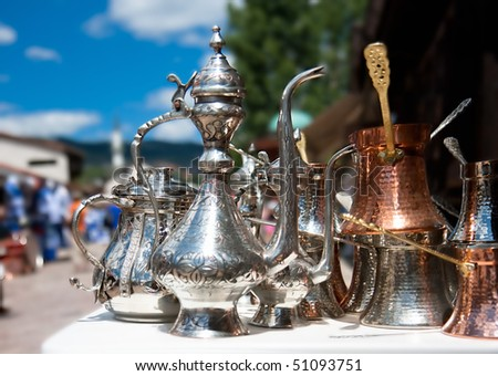 Vintage metal  teapots , street background - stock photo