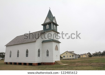 Vintage Methodist Church is one of many vacated buildings in Portsmouth Village after the last residents left the Cape Lookout National Seashore island in 1971.  North Carolina Outer Banks. - stock photo