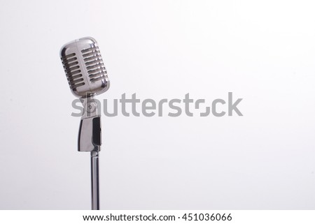 vintage microphone isolated - stock photo