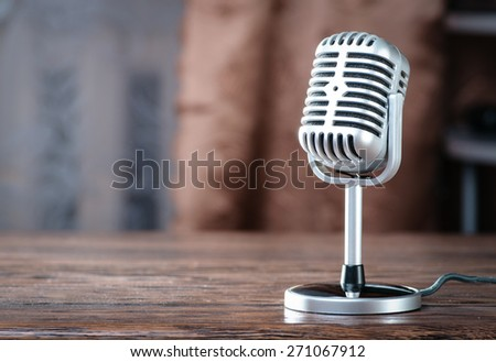 Vintage microphone on the table - stock photo