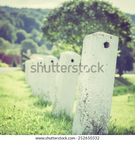 Vintage Milestone in a Rural Area - stock photo