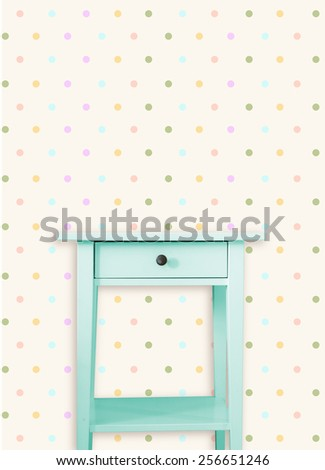 Vintage mint wooden chest drawer near vintage dots wall - stock photo