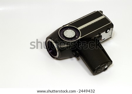 Vintage 8mm home movie camera on white background - stock photo