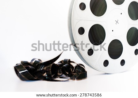 Vintage 35 mm movie cinema reel on white background film unrolled and copy space - stock photo