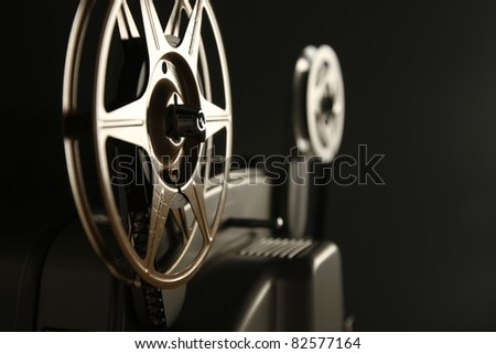 Vintage 8mm Projector Spools in Dark Room - stock photo
