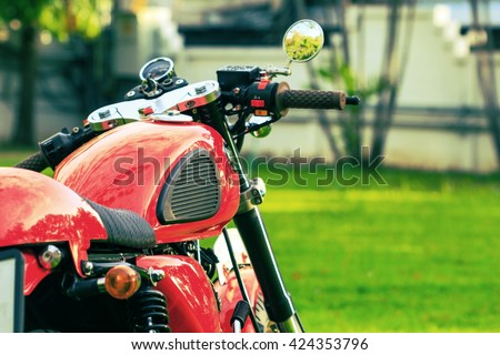 vintage motorcycles detail on a green lawn - stock photo