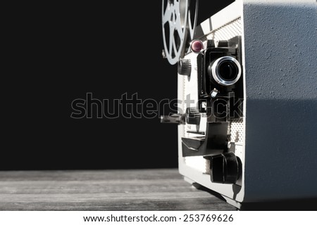 Vintage movie projector. Edited with vintage faded colors - stock photo