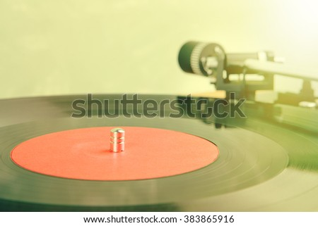 vintage music player turntable with lp - stock photo