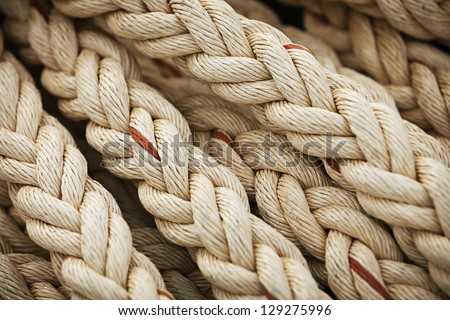 Vintage nautical knots. Big marine sea ropes in heap - the background - stock photo