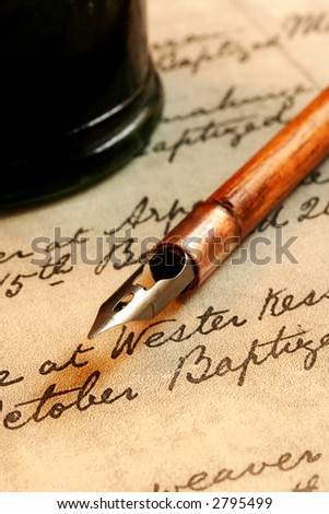 Vintage nib pen and inkwell, on a page of 18th century script.
