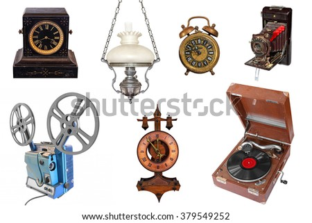 Vintage objects isolated on white background. Vintage and antique alarm clock, desktop clock, lamp, photo camera, reel movie projector and record player  - stock photo