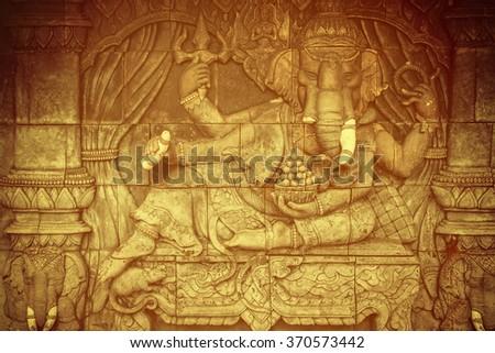 Vintage of Ganesha god statue in public temple in Thailand, Ganesha God is elephant God in Hindu religion. - stock photo