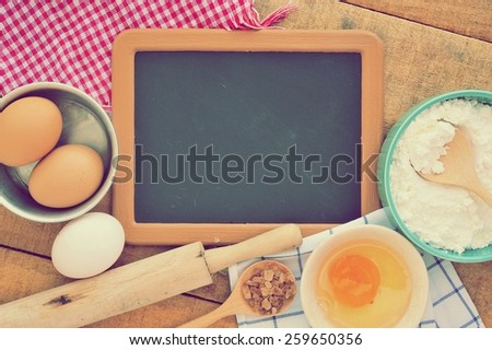 Vintage of the old blank small blackboard with ingredients of cake. - stock photo