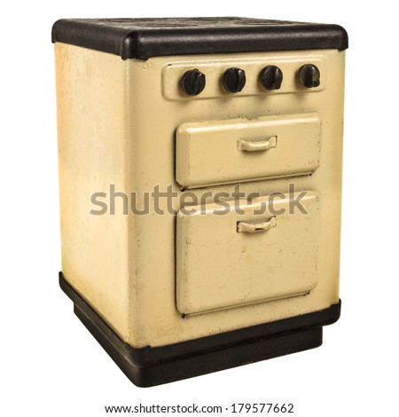 Vintage off white doll house cooking stove isolated on a white background - stock photo