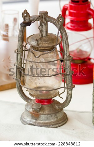 vintage oil lamp at a flea market - stock photo