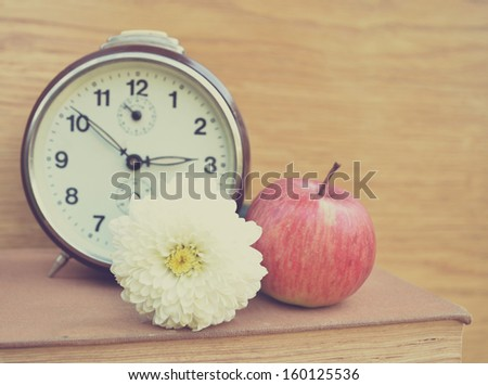 Vintage old clock and apple - stock photo