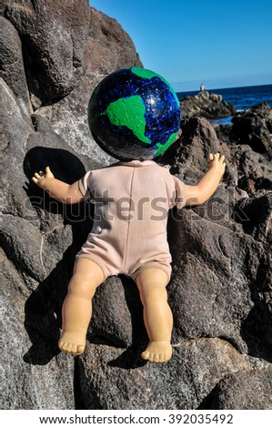 Vintage Old Doll with a Globe - stock photo
