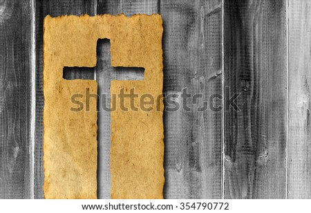 Vintage old grungy paper banner with a Christian religious cross over ancient wood for religion or faith designs for religion, retro, aged, grunge, faith, holiday, God, religious, Jesus belief designs - stock photo