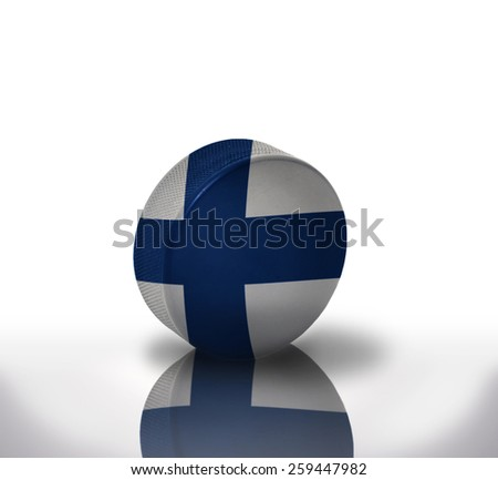 vintage old hockey puck with the finnish flag - stock photo