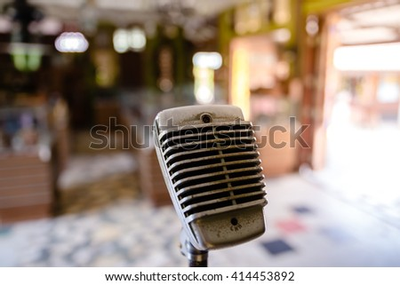 Vintage old microphone in party - stock photo