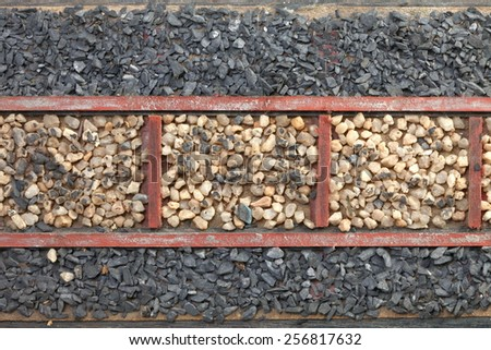 Vintage old model of railway track and stone ballast for railway track represent the railway transportation equipment. - stock photo