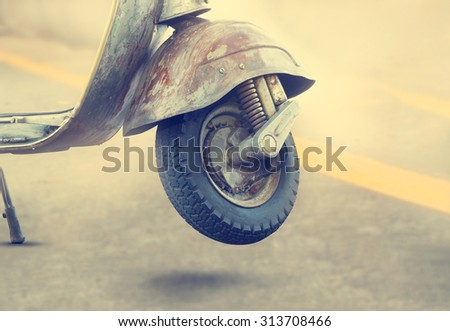 Vintage old motorcycle detail on street background - stock photo