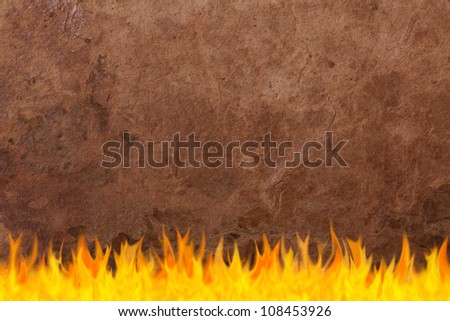 Vintage old paper texture on fire, background. - stock photo