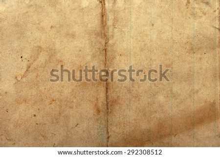 Vintage old paper, yellowed and darkened with age. - stock photo