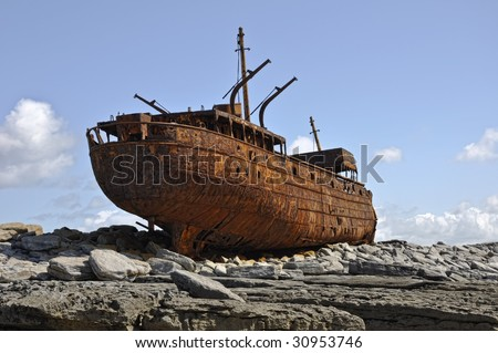 vintage old rusty sailing ship in need of repair - stock photo