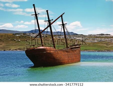 Vintage old ship in lagoon, Falkland islands - stock photo