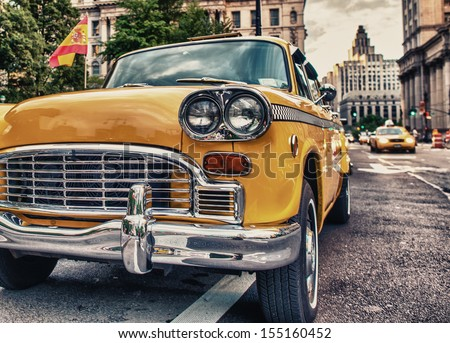Vintage old Taxi in New York City. Classic Yellow Cab in Manhattan. - stock photo