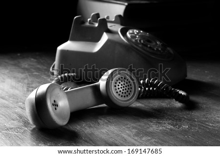 vintage old telephone, black retro phone is on the wooden table, still life