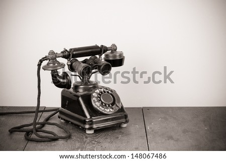 Vintage old telephone with binoculars concept still life - stock photo
