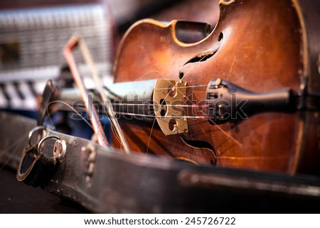 Vintage old used violin and bow. Shallow Depth of field - stock photo