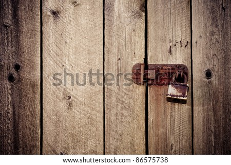 vintage old wood background with lock - stock photo