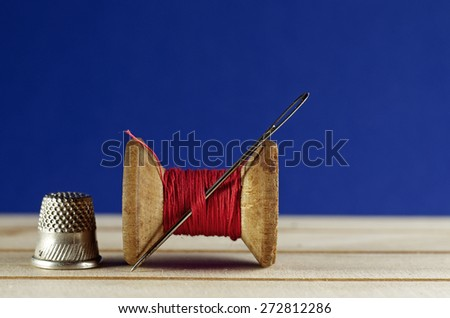 Vintage old wooden sewing thread / spool of thread  / bobbin closeup.textile or fine cloth making. - stock photo