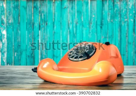 Vintage orange phone - stock photo